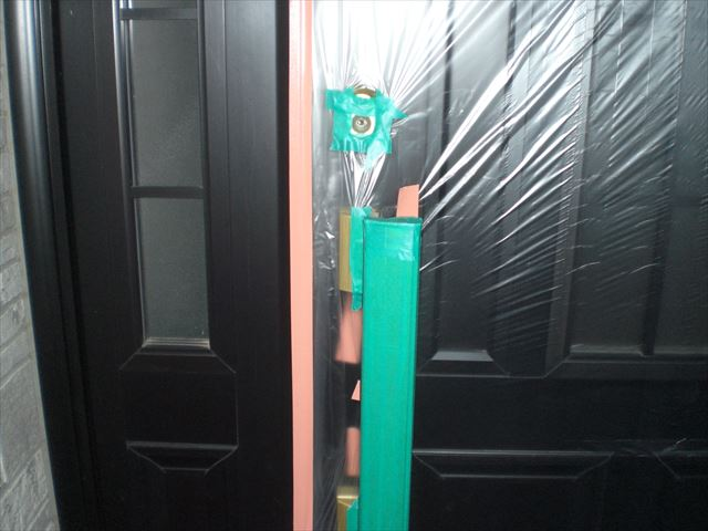 玄関ドア養生鍵穴